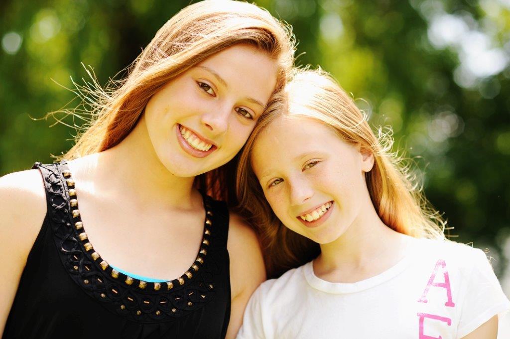 sisters smiling - syracuse, ny